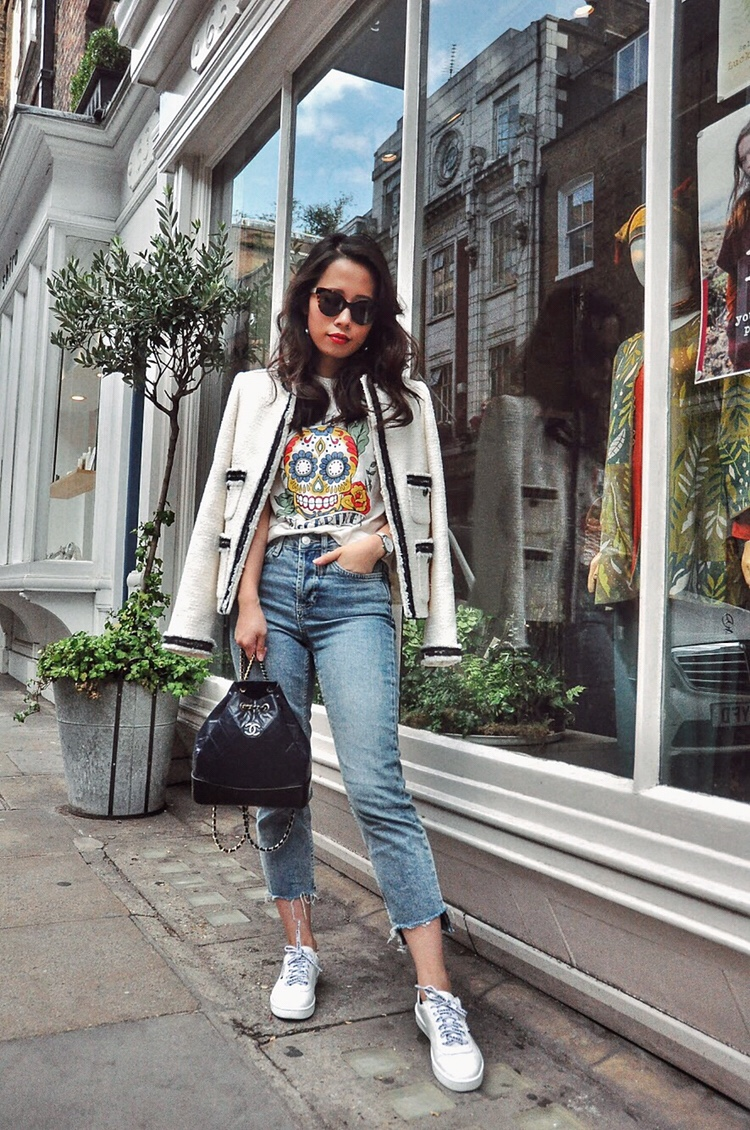 Wearing LK Bennett white Charlee cream tweed jacket, Jimmy Fairly cateye sunglasses, Stella McCartney white tshirt, topshop moto blue jeans, chanel white sneakers trainers and Chanel Gabrielle backpack in navy black.