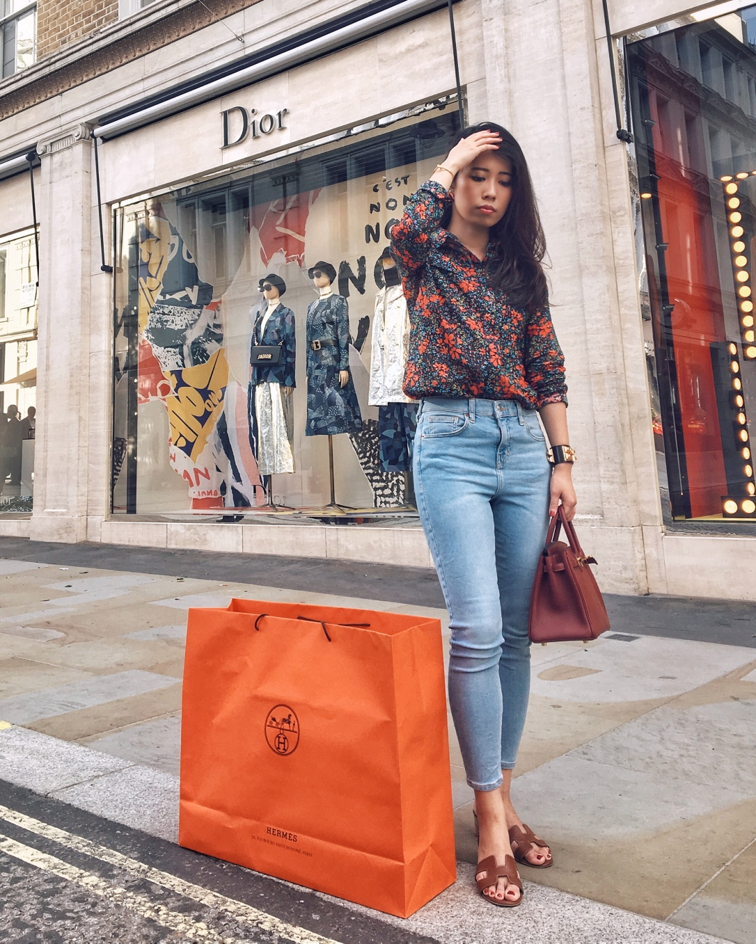 Wearing whistles floral shirt, topshop jeans, carrying Birkin 25 bag in Rouge H and gold Hermes sandals with black gold CDC. Hermes shopping bag with my new purchase Lindy 26 in Rose Azalee